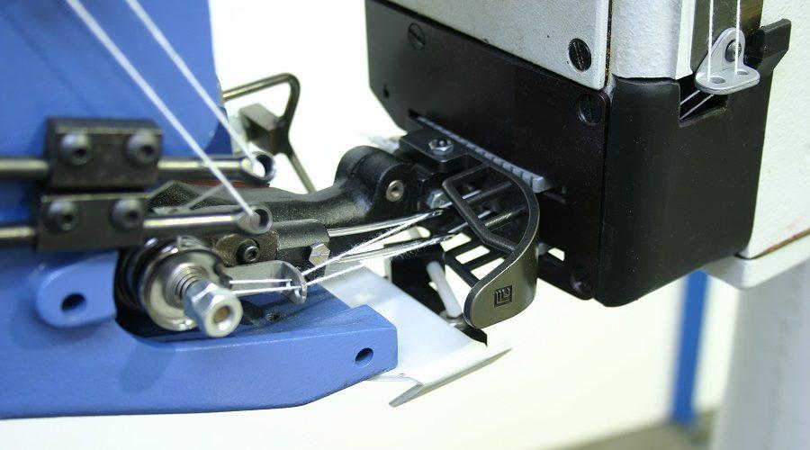 Fischbein double stitcher Buckle Packaging